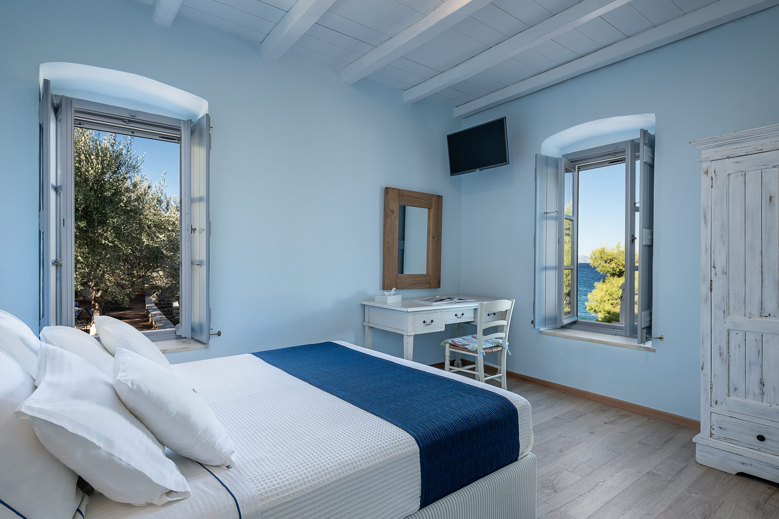 Summer suite bedroom and sea view from two windows.