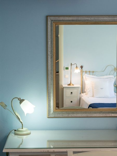 Thalassa suite, vanity table's mirror image of bed.