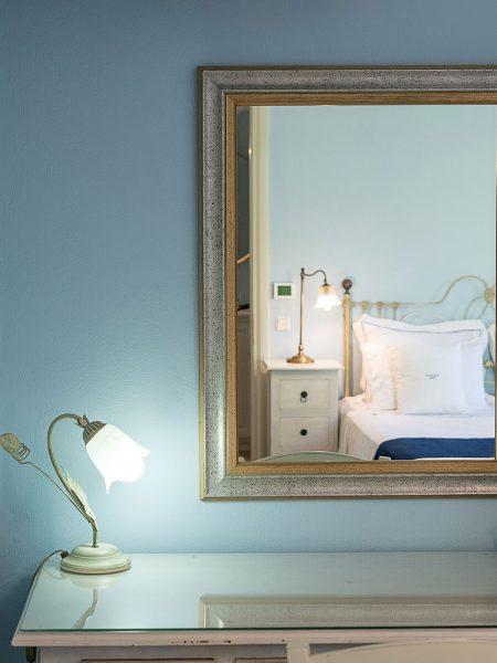 Thalassa suite, vanity table's mirror image of bed.