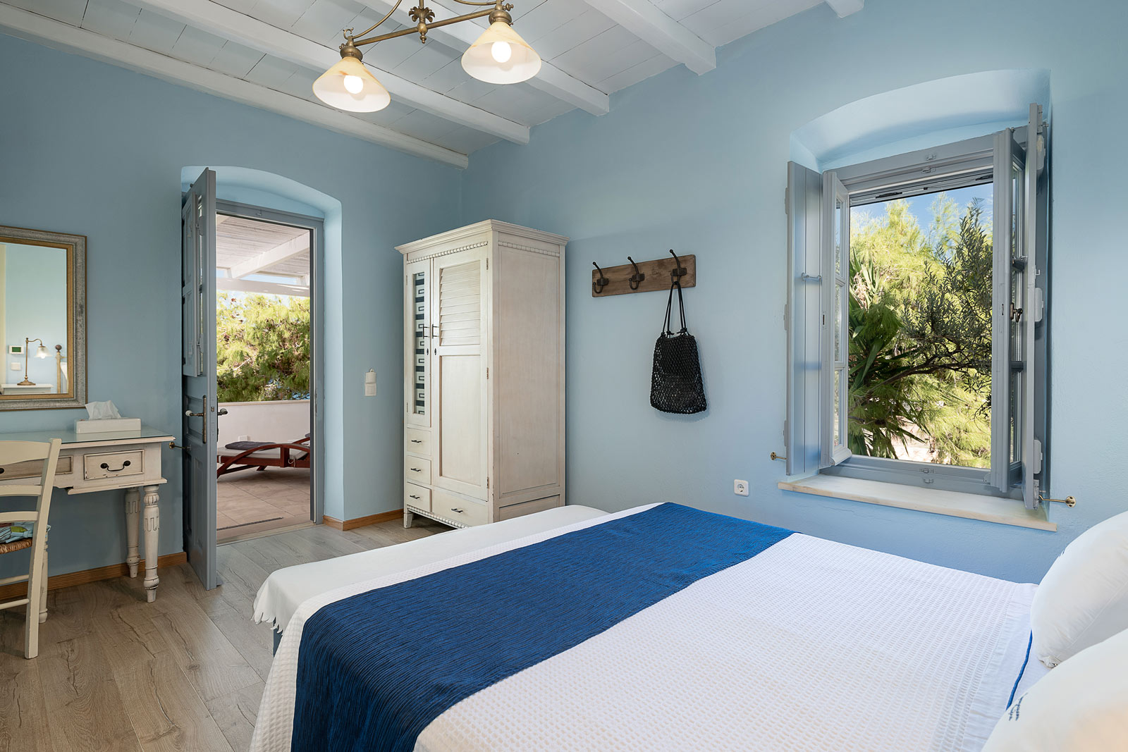 Thalassa suite, bedroom with closet, vanity table, open door to balconi.